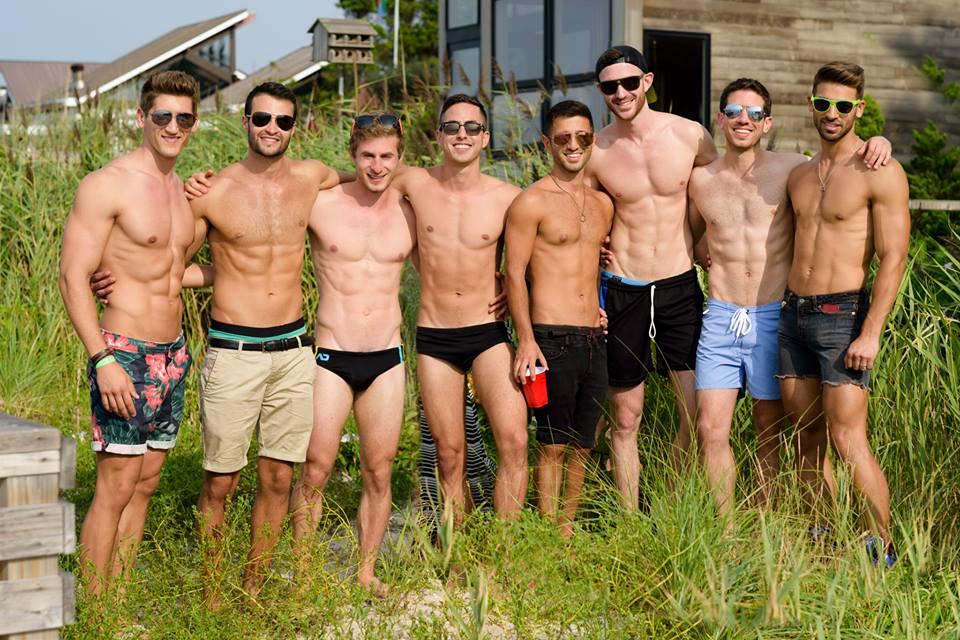 Line of beautiful men on Fire Island beach