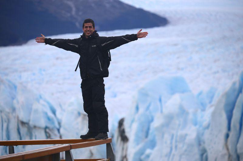 At the edge of a cliff om Argentina's Glacial Perito Moreno